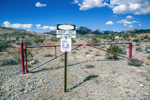 A sign is posted in the Desert National Wildlife Refuge warning travelers not to trespass on the gunnery range is seen, Friday, Sept. 30, 2016. The Air Force prepares to hold public meetings on a  ...