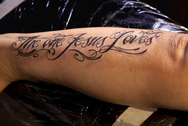 "Verve Church Pastor Vince Antonucci receives the tattoo, ""The One Jesus Loves,"" by tattoo artist Tommy Altman during his sermon on being accepted for who we are at the Verve Church in Las Vegas on ..."