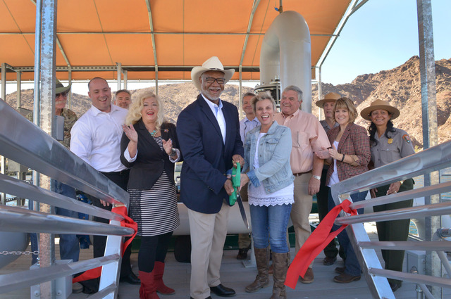 Dr. Benjamin Tuggle, Regional Director USFWS Southwest Region with Hildy Angius Mohave County Supervisor share the duty of ribbon cutting welcoming rainbow trout back to Willow Beach National Fish ...