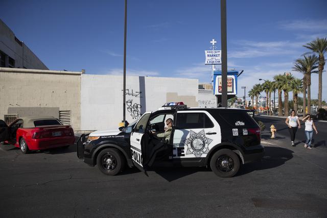 Las Vegas police officer Carlos Acevedo makes a traffic stop on Las Vegas Boulevard North on Saturday, Oct. 8, 2016, in Las Vegas. (Erik Verduzco/Las Vegas Review-Journal Follow @Erik_Verduzco)
