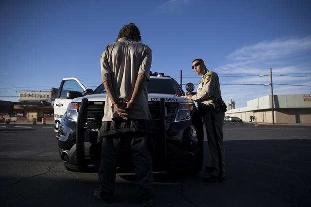 Las Vegas police officer Carlos Acevedo speaks to a man detained for trespassing on Las Vegas Boulevard North on Saturday, Oct. 8, 2016, in Las Vegas. (Erik Verduzco/Las Vegas Review-Journal Follo ...