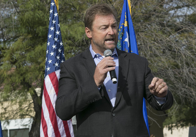 U.S. Sen. Dean Heller, R-Nev., speaks to a crowd at a campaign rally outside the Summerlin campaign headquarters of U.S. Rep. Cresent Hardy, R-Nev., in Las Vegas on Oct. 8, 2016. Richard Brian/Las ...