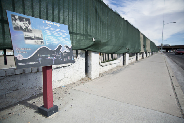A sign denoting the historic significance of the Moulin Rouge casino stands outside the restoration site near Bonanza Road and Martin Luther King Boulevard in Las Vegas on Friday, Oct. 14, 2016. D ...
