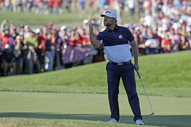 United States' Ryan Moore reacts after winning the 17th hole during a singles match at the Ryder Cup golf tournament Sunday, Oct. 2, 2016, at Hazeltine National Golf Club in Chaska, Minn. (Chris ...