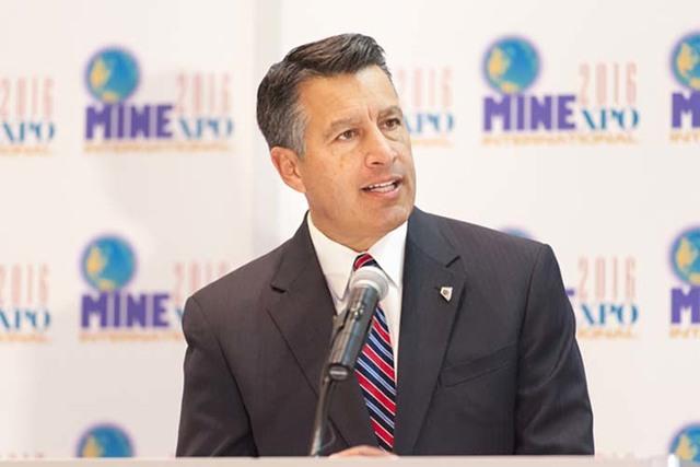 Nevada Gov. Brian Sandoval speaks at the opening of the MINExpo International mining equipment show in Las Vegas on Monday, Sept. 26, 2016. (Mark Damon/Las Vegas News Bureau)