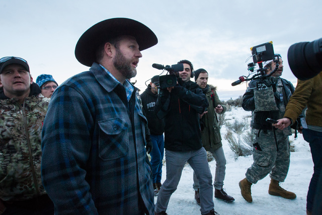 Conservative radio host Pete Santilli, right, follows Ammon Bundy, left, at the Malheur National Wildlife Refuge headquarters near Burns, Ore. on Thursday, Jan. 7, 2016. (Chase Stevens/Las Vegas R ...