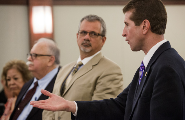 Clark County Deputy District Attorney Michael Staudaher, right, speaks during arraignment of five defendants charged with theft on  Wednesday, July 30, 2014 in  Regional Justice Center.  Also pict ...
