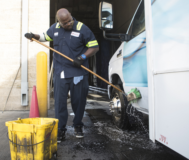 Christopher Ellis, a 40-year-old man who spent 20 years in prison, washes a bus at the RTC Sunset Operations and Maintenance Facility on Friday, Oct. 7, 2016, in Las Vegas. (Loren Townsley/Las Veg ...