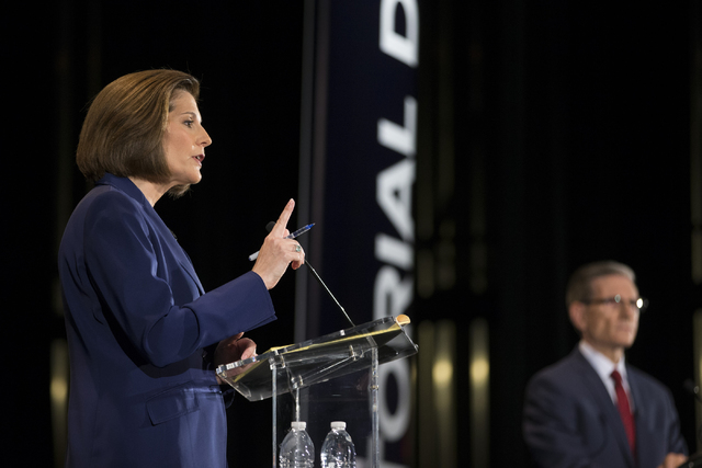 Democratic U.S. Senate candidate Catherine Cortez Masto, speaks with U.S. Rep. Joe Heck, R-Nev., during the Nevada Senatorial Debate at Canyon Springs High School on Friday, Oct. 14, 2016, in Nort ...