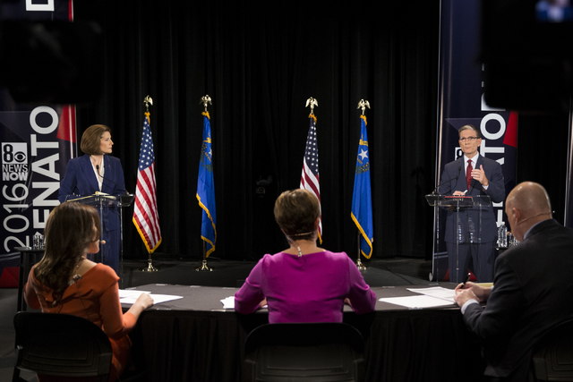 Democratic U.S. Senate candidate Catherine Cortez Masto, left, listens to U.S. Rep. Joe Heck, R-Nev., during the Nevada Senatorial Debate at Canyon Springs High School on Friday, Oct. 14, 2016, in ...