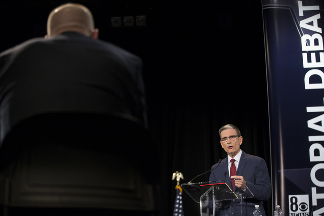 U.S. Rep. Joe Heck, R-Nev., speaks during the Nevada Senatorial Debate at Canyon Springs High School on Friday, Oct. 14, 2016, in North Las Vegas. The debate between Heck and Democratic U.S. Senat ...
