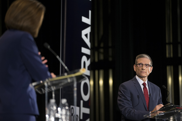U.S. Rep. Joe Heck, R-Nev., listens to Democratic U.S. Senate candidate Catherine Cortez Masto during the Nevada Senatorial Debate at Canyon Springs High School on Friday, Oct. 14, 2016, in North  ...