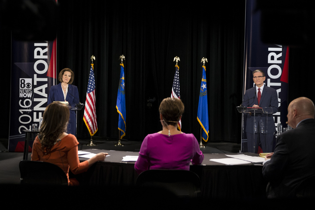 Democratic U.S. Senate candidate Catherine Cortez Masto, with U.S. Rep. Joe Heck, R-Nev., participate during the Nevada Senatorial Debate at Canyon Springs High School on Friday, Oct. 14, 2016, in ...