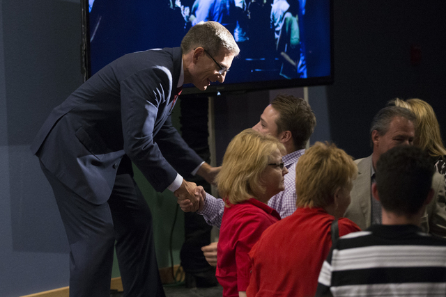 U.S. Rep. Joe Heck, R-Nev., greets supporters after the Nevada Senatorial Debate at Canyon Springs High School on Friday, Oct. 14, 2016, in North Las Vegas. The debate between Heck and Democratic  ...
