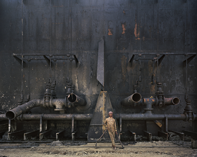 "A worker at the shipbreaking yards in Chittagong, Bangladesh, stares into photographer Edward Burtynsky's camera in 2000 for an image featured in ""The End of Oil"" section of ""Oil,"" which continues ..."