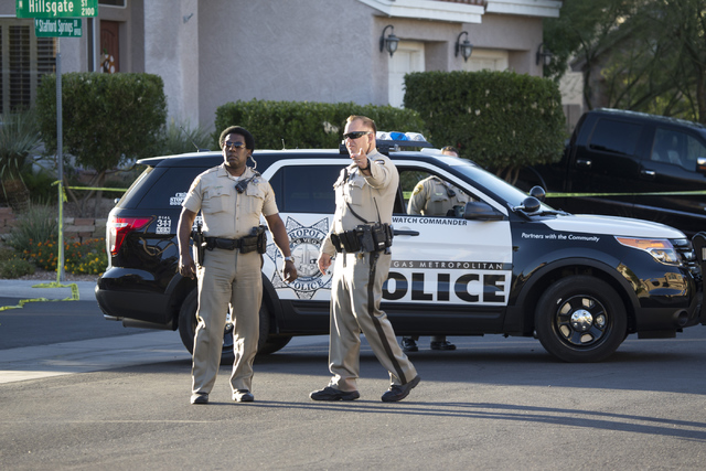 The scene near a shooting is seen at the intersection of Hillsgate Street and Staffords Spring Drive on Tuesday, Oct. 4, 2016, in Las Vegas. (Erik Verduzco/Las Vegas Review-Journal) Follow @Erik_V ...