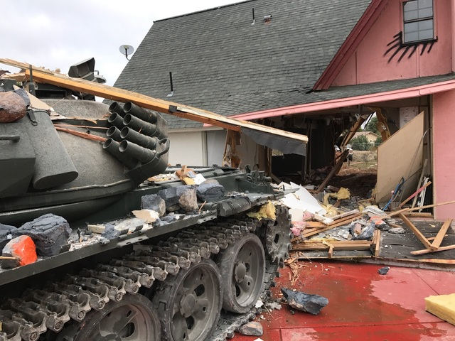 """Finality at """"The Slammer"""" as a Russian tank blasts through the A-frame house and into the back yard. (Courtesy Penn Jillette)"""