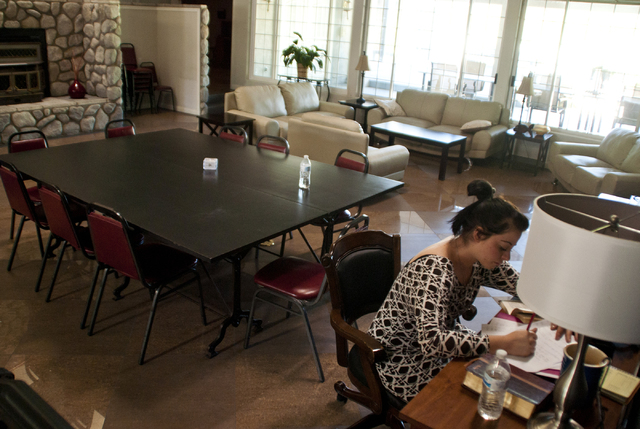 Hailey (last name withheld) studies in the living room of the Walter Hoving Home in Las Vegas Sept. 19, 2016. The home specializes in using religion as a tool to help women struggling with drug an ...