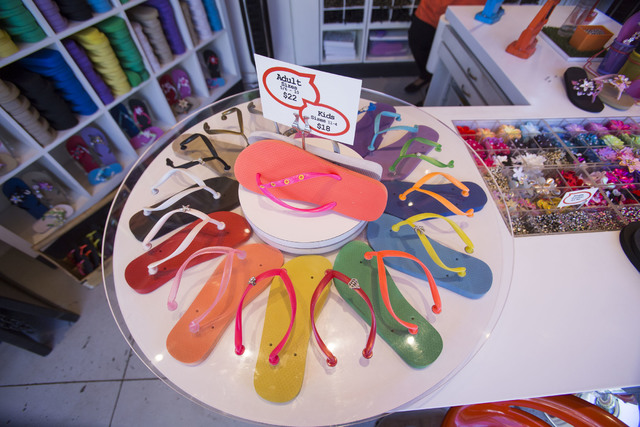 A customizable flip flops display wheel on display at the Flip Flop Workshop outdoor kiosk at the Fashion Show Mall on Tuesday, Oct. 4, 2016. Richard Brian/Las Vegas Review-Journal Follow @vegasph ...