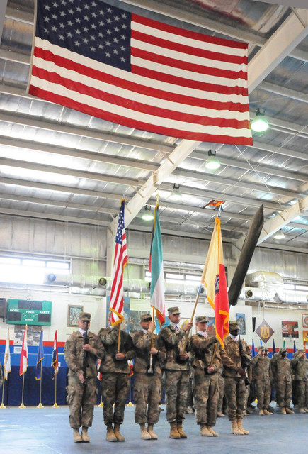 A color guard composed of soldiers assigned to the 17th Sustainment Brigade and the 369th Sustainment Brigade, 1st Sustainment Command (Theater), present the colors for the playing of the Kuwaiti  ...