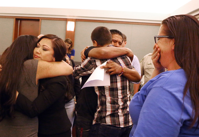 Family members of homicide victim Marcos Arenas, including his father Ivan, center, react after hearing the jury's verdict at the Regional Justice Center on Wednesday, Aug. 31, 2016. Michael Solid ...