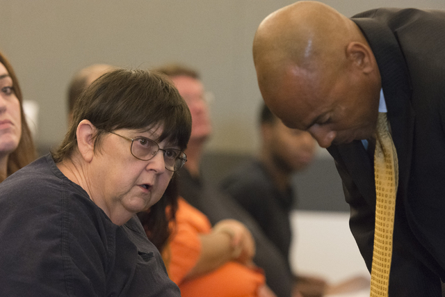 Roxanne Sparks, left, a former bookkeeper accused of transferring more than $200,000 between two of her clients' accounts, speaks with her attorney, Carl Arnold, during sentencing at the Regional  ...