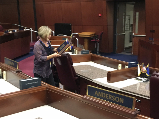 Mary Matheus, deputy sergeant at arms for the Assembly, readies the Assembly chamber in Carson City on Friday, Oct. 7, 2016, for the special session set to begin Monday. Sean Whaley/Las Vegas Revi ...