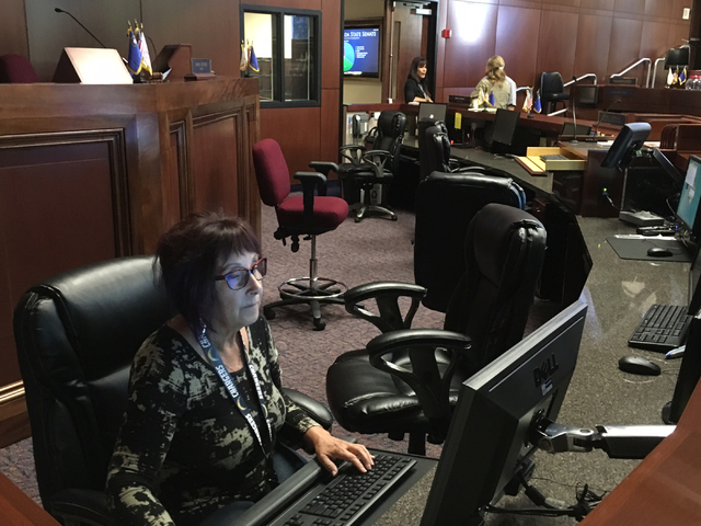 Diana Jones, recording clerk for the state Senate, checks to make sure the computer systems are functioning properly on Friday, Oct. 7, 2016, ahead of a special session set to begin in Carson City ...