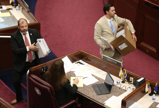 Majority Floor Leader Paul Anderson, left, and Assemblyman Stephen Silberkraus hand out agendas during day one of the 30th Special Session of the Nevada Legislature, Monday, Oct. 10, 2016 in Carso ...