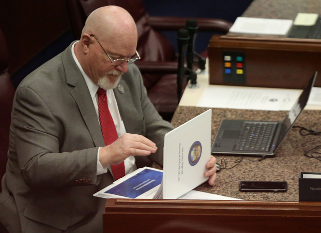Assemblyman Randy Kirner flips through the agenda during day one of the 30th Special Session of the Nevada Legislature, Monday, Oct. 10, 2016 in Carson City, Nev. (David Guzman/Las Vegas Review-Jo ...
