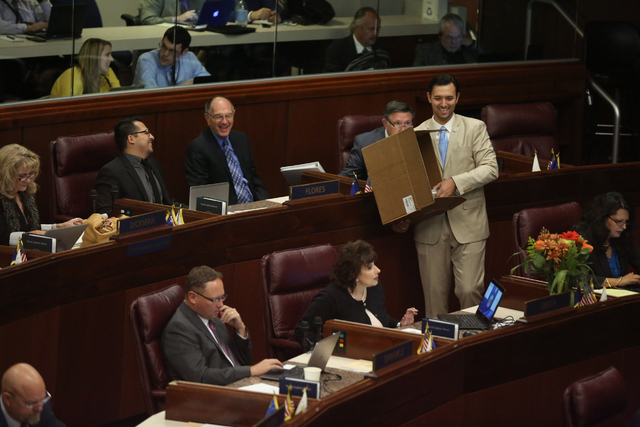 Assemblyman Stephen Silberkraus passes out agendas during day one of the 30th Special Session of the Nevada Legislature, Monday, Oct. 10, 2016 in Carson City, Nev. (David Guzman/Las Vegas Review-J ...