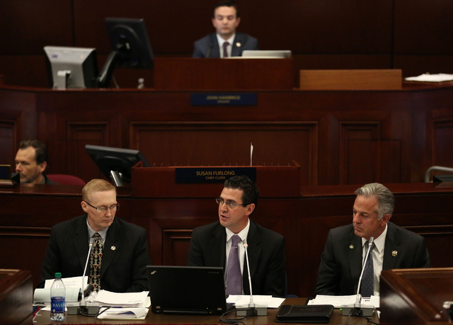 Jeremy Aguero, principle analyst of Applied Analysis, center, speaks during day one of the 30th Special Session of the Nevada Legislature, Monday, Oct. 10, 2016 in Carson City, Nev. (David Guzman/ ...