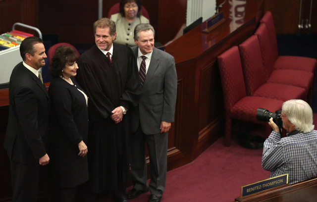 From left, Assemblyman Dominic Brunetti, Assemblywoman Stephanie Smith, Nevada Supreme Court Justice Ron Parraguirre and Assemblyman Kyle James Stephens pose for a photograph during day one of the ...