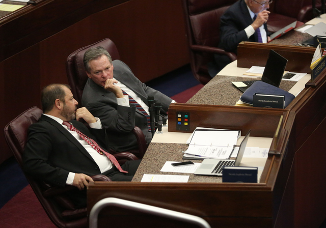 Majority Floor Leader Paul Anderson, left, speaks with Assemblyman Kyle James Stephens during day one of the 30th Special Session of the Nevada Legislature, Monday, Oct. 10, 2016 in Carson City, N ...