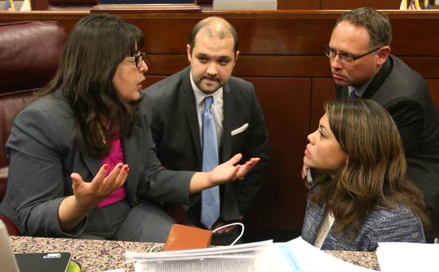 Nevada Assembly Democrats from left, Irene Bustamante Adams, Jakob Stewart, with the Assembly Democratic Caucus, Assembly members Mike Sprinkle and Teresa Benitez-Thompson talk on the Assembly flo ...