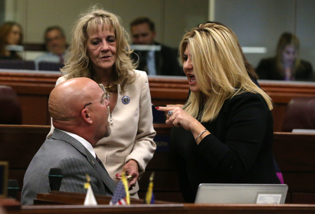 Nevada Assembly Republicans, from left, Ira Hansen, Jill Dickman and Michele Fiore talk on the Assembly floor during a special session at the Nevada Legislature in Carson City, Nev. on Thursday, O ...