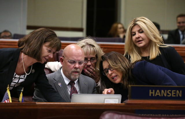 Nevada Assembly Republicans, from left, Robin Titus, Ira Hansen, Jill Dickman, Victoria Seaman and Michele Fiore talk on the Assembly floor during a special session at the Nevada Legislature in Ca ...