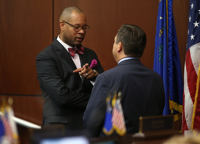 Nevada Senate Minority Leader Aaron Ford, D-Las Vegas, left, and Majority Leader Michael Roberson, R-Henderson, talk during a special session at the Legislative Building in Carson City, Nev. on Th ...