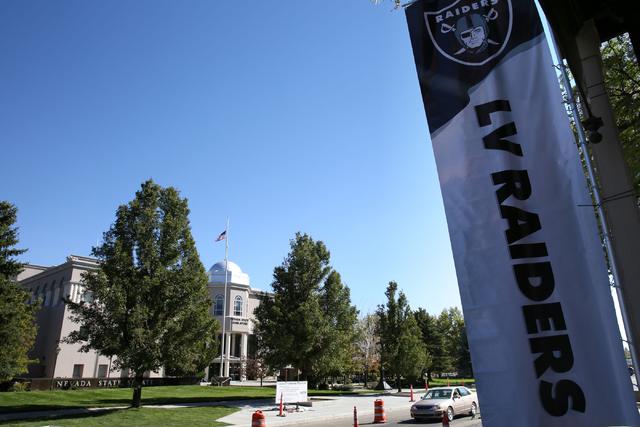 A Las Vegas Raiders banner hangs outside Firkin & Fox near the Nevada Legislative Building in Carson City, Nev., Oct. 9, 2016.  Gov. Brian Sandoval summoned Nevada lawmakers to Carson City for ...