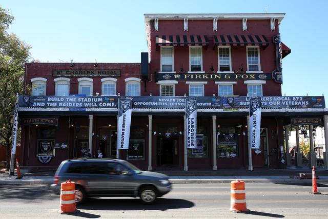 Las Vegas Raiders banners hang outside Firkin & Fox near the Nevada Legislative Building in Carson City, Nev., Oct. 9, 2016. Gov. Brian Sandoval summoned Nevada lawmakers to Carson City for a  ...