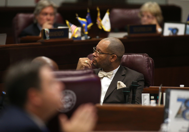 Nevada Senate Minority Leader Aaron Ford, D-Las Vegas, listens to debate on the Senate floor on a proposal to help fund a football stadium and convention center improvements in Las Vegas during a  ...