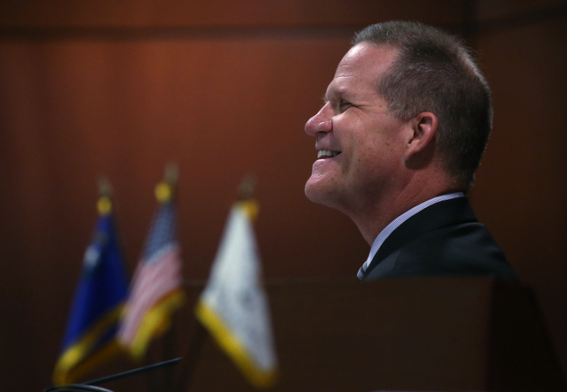 Lt. Gov. Mark Hutchison listens to debate on the Senate floor on a proposal to help fund a football stadium and convention center improvements in Las Vegas during a special session at the Nevada L ...