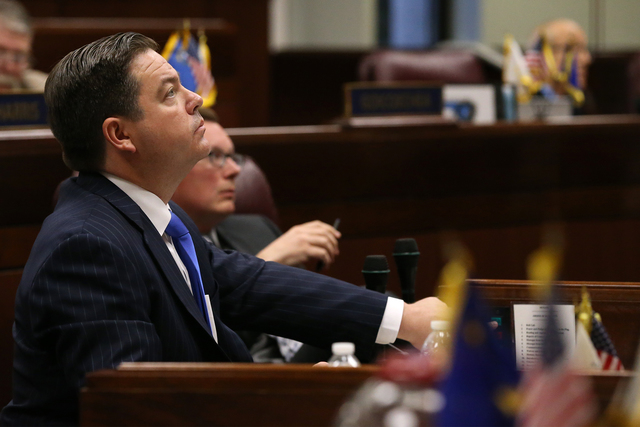 Nevada Senate Majority Leader Michael Roberson, R-Henderson, watches votes tally on the big screen on the Senate floor on a proposal to help fund a football stadium and convention center improveme ...