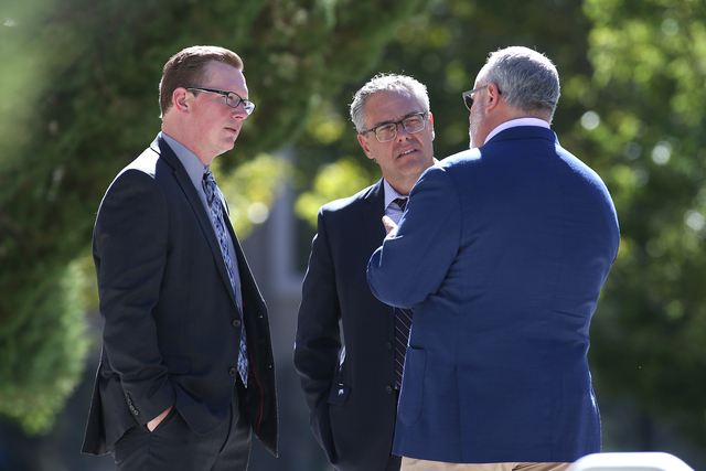 From left, Nevada Sen. Ben Kieckhefer, R-Reno, Dale Erquiaga with Communities in Schools and lobbyist Pete Ernaut talk outside the Nevada Legislature in Carson City, Nev. on Tuesday, Oct. 11, 2016 ...