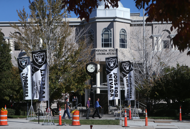 Banners from the Laborers' International Union of North America adorn the sidewalk in front of the Nevada Legislature in Carson City, Nev. on Tuesday, Oct. 11, 2016. Lawmakers are considering publ ...