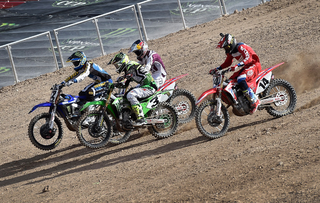 Super cross riders from left, Chad Reed, Eli Tomac, Ken Roczen and Cole Seely race down on the dirt track at Sam Boyd Stadium following a news conference Friday, Oct. 14, 2016, in Las Vegas. David ...