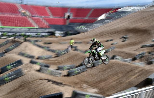 Super cross rider Eli Tomac flies high over the dirt track at Sam Boyd Stadium following a news conference Friday, Oct. 14, 2016, in Las Vegas. David Becker/Las Vegas Review-Journal Follow @davidj ...