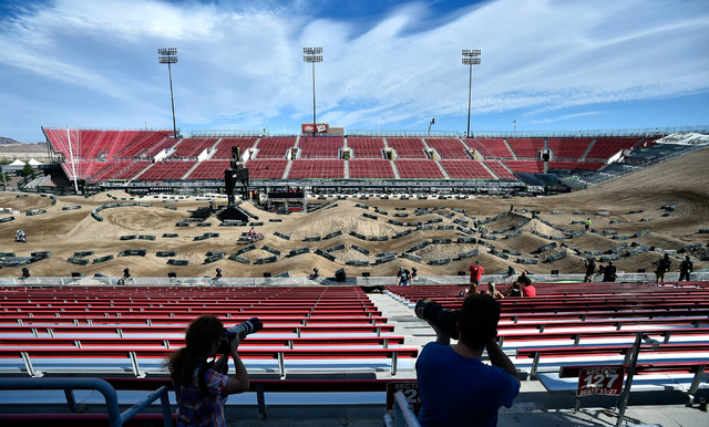Photographers capture super cross riders as they traverse the dirt track at Sam Boyd Stadium following a news conference Friday, Oct. 14, 2016, in Las Vegas. David Becker/Las Vegas Review-Journal  ...