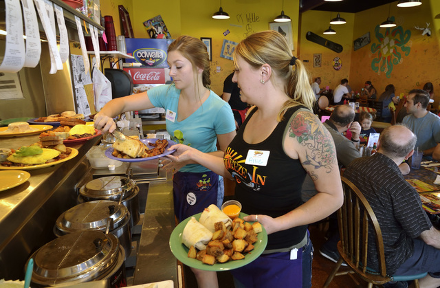 Hostess Chelsea Pond, left, and general manager Allie Duby work to get food orders to customers at Squeeze In at 5165 Fort Apache Road in Las Vegas on Saturday, Oct. 22, 2016. Bill Hughes/Las Vega ...