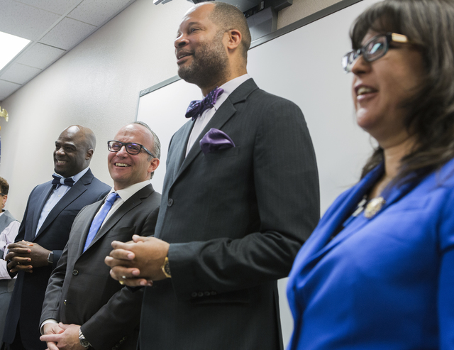 Sen. Aaron Ford, second from right,  speaks during a news conference discussing benefits for employment at the stadium project, Thursday, Oct. 27, 2016, at the Urban Chamber of Commerce in North L ...